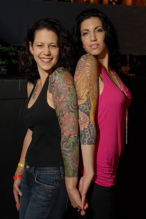 New York City Tattoo Convention 2009 at the Roseland Ballroom: Nicky Aives (left) and Cindy Rolenc with matching flowers by Dana Halmuth at new York Adorned.