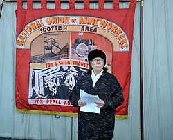 Pictured: Friend of Mick McGahey and fellow Communist Party member Pat Milligan speaking at the wreath laying.<br /> <br /> Labour MSP's and National Union of Mineworkers (NUM) campaigners laid wreaths and held a short vigil outside the Scottish Parliament. Speakers included Scottish Labour leader Richard Leonard, NUM president Nicky Wilson and Mick's son, Michael MxGahey.<br /> <br /> &copy; Dave Johnston / EEm