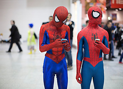 © Licensed to London News Pictures. 24/10/2015. London, UK. A couple of Cosplayers dressed as Spiderman at the MCM London Comic Con in London ExCeL on Saturday October 24th. Photo credit : Isabel Infantes/LNP