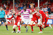 Barnet FC Striker John Akinde (9) powers his way through the Crawley defence during the Sky Bet League 2 match between Crawley Town and Barnet at the Checkatrade.com Stadium, Crawley, England on 7 May 2016. Photo by Andy Walter.