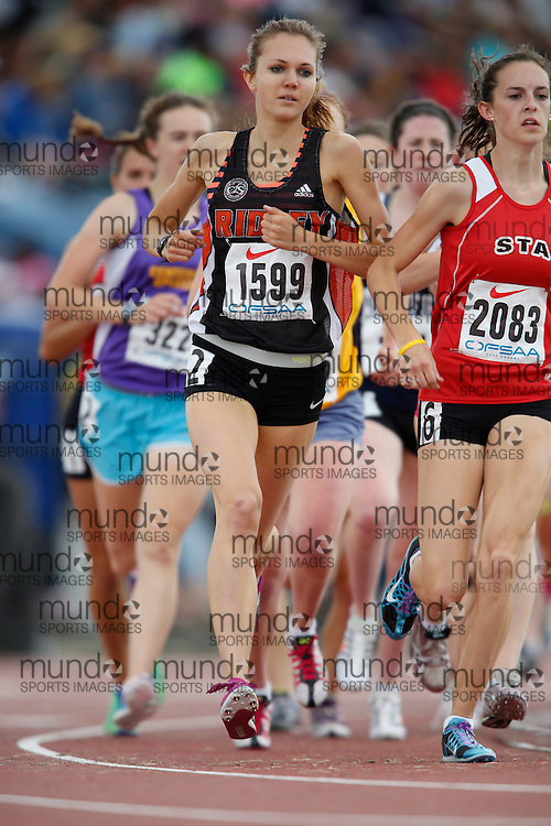 Heather Petrick of Ridley College - St Catharines competes in the senior girls 3000m at the 2013 OFSAA Track and Field Championship in Oshawa Ontario, Saturday,  June 8, 2013.<br /> Mundo Sport Images/ Geoff Robins