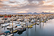 Sunset over the City of Homer Port & Harbor marina on the Kachemak Bay overlooking the Kenai Mountains in Homer, Alaska.