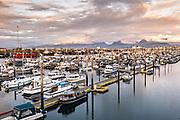 Sunset over the City of Homer Port & Harbor marina on the Kachemak Bay overlooking the Kenai Mountains in Homer, Alaska.