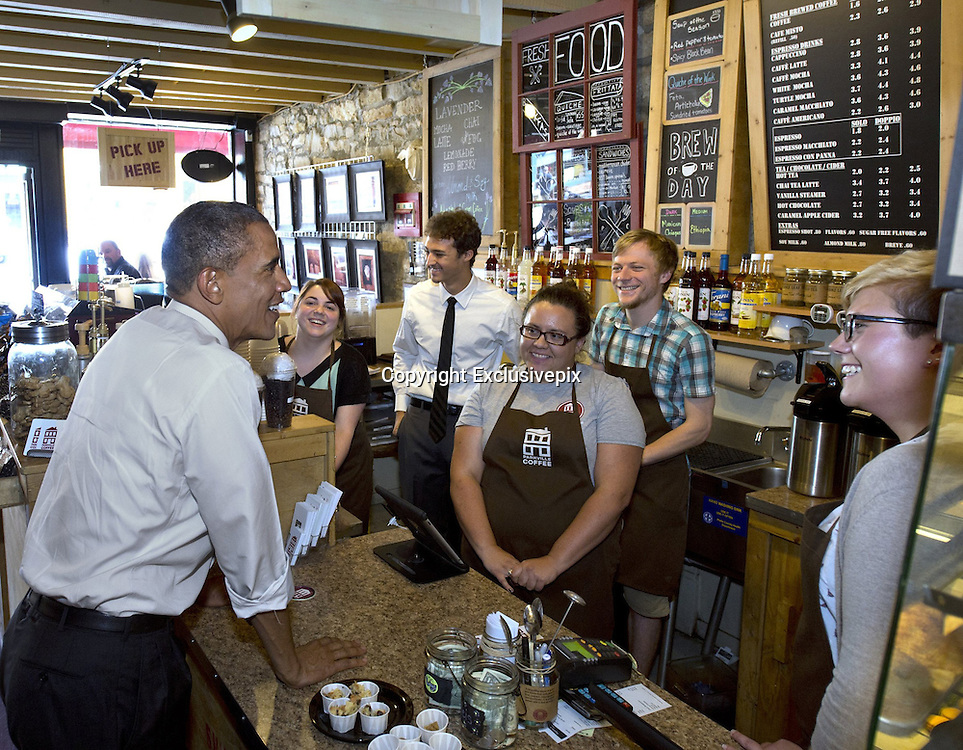 July 30, 2014 - Parkville, Missouri, U.S. - <br /> <br /> President Obama Visits Kansas City<br /> <br /> President BARACK OBAMA ordered iced tea and sampled some food while at Parkville Coffee during an unscheduled stop.  Obama also bought some cups of coffee and tea for some of the other patrons in the coffee shop.<br /> ©Exclusivepix