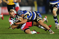 Ross Chisholm of Harlequins is tackled by Leroy Houston of Bath Rugby - Photo mandatory by-line: Patrick Khachfe/JMP - Mobile: 07966 386802 28/11/2014 - SPORT - RUGBY UNION - Bath - The Recreation Ground - Bath Rugby v Harlequins - Aviva Premiership