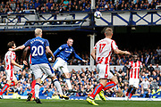 Wayne Rooney (10) heads in the opening goal for Everton 1-0 during the Premier League match between Everton and Stoke City at Goodison Park, Liverpool, England on 12 August 2017. Photo by Craig Galloway.