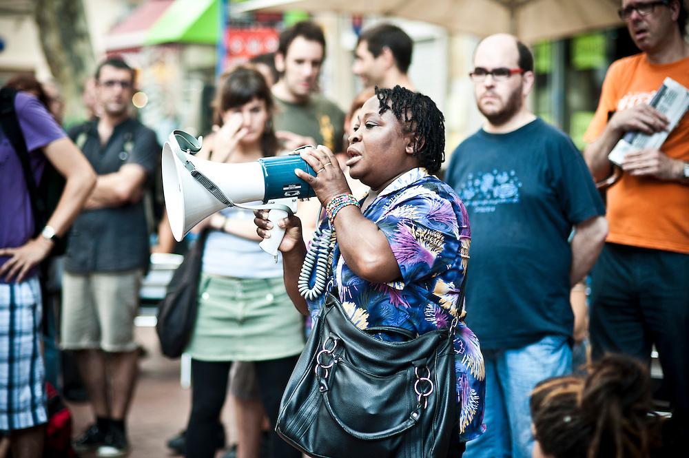 Barcelona, Spain. A woman speaks during a neighborhood assembly.