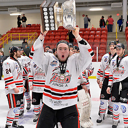 FORT FRANCES, ON - May 2, 2015 : Central Canadian Junior &quot;A&quot; Championship, game action between the Fort Frances Lakers and the Soo Thunderbirds, Championship game of the Dudley Hewitt Cup. Caleb Bowman #21 of the Soo Thunderbirds raises the Dudley Hewitt Cup.<br /> (Photo by Shawn Muir / OJHL Images)