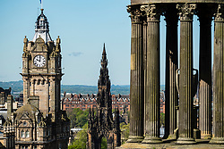 View of clocktower on Balmoral Hotel, Scott Monument and Dugald Stewart Monument in Edinburgh, Scotland, UK.