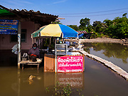 01 NOVEMBER 2017 - KOP CHAO, NAKHON SI AYUTTHAYA: Many communities north of Bangkok are flooded because dams have been opened to reliever pressure on reservoirs.    PHOTO BY JACK KURTZ