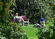 © Licensed to London News Pictures. 25/04/2013. Chiswick, UK Two women and children enjoy the sun. People enjoy the sunshine in the grounds of Chiswick House in West London today 25th April 2013. Photo credit : Stephen Simpson/LNP