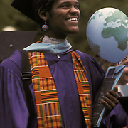 African American woman at NYU college graduation in cap and gown, this is one of lifes major events