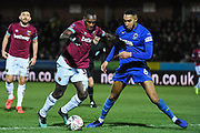 West Ham United  midfielder Michail Antonio (30) and Wimbledon defender Terell Thomas (6) in action during the The FA Cup fourth round match between AFC Wimbledon and West Ham United at the Cherry Red Records Stadium, Kingston, England on 26 January 2019.