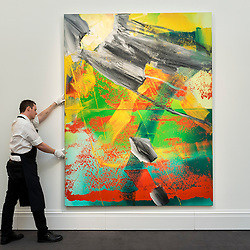 "© Licensed to London News Pictures. 30/09/2016. London, UK.  ""Garten"" by Gerhard Richter (est. GBP3-4 million) is checked by a technician at the preview of Sotheby's London upcoming Contemporary Art Auctions.  Photo credit : Stephen Chung/LNP"