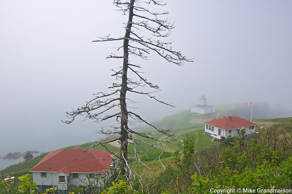 Lighhouse and lightkeeper's house in fog on Bay of Fundy, Cape d'Or, Nova Scotia, Canada