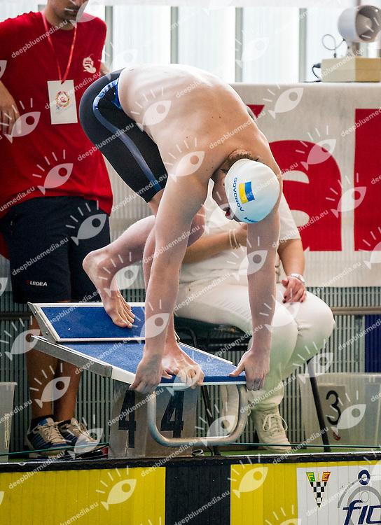 Andriy Govorov Ucraino, nativo di Sebastopoli, Mostra una bandiera del suo paese con la scritta (pace&quot; mentre sale sul blocco di partenza nella prima serie dei 50 Farfalle nella seconda giornata del IV trofeo citta di Milano<br /> IV Trofeo Citta di Milano Swimming Nuoto<br /> Day02 - 8 March 2014<br /> D. Samuele Swimming Pool<br /> Milano Italy<br /> Photo P.Mesiano/Deepbluemedia/Inside