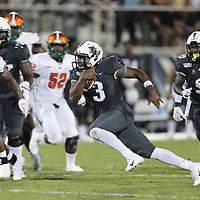 ORLANDO, FL - AUGUST 29: Brandon Wimbush #3 of the UCF Knights runs with the ball past Renaldo Flowers Jr. #96 and Derrick Mayweather #52 of the Florida A&M Rattlers during a NCAA football game on August 29 2019 in Orlando, Florida. (Photo by Alex Menendez/Getty Images) *** Local Caption *** Brandon Wimbush;Renaldo Flowers Jr.; Derrick Mayweather