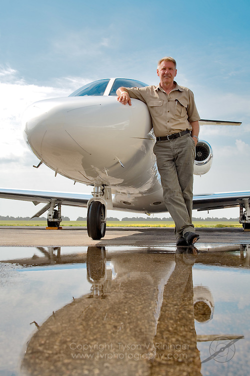 Portrait of Harrison Ford next to his Cessna Citation III Jet during Airventure 2006 in Oshkosh, Wisconsin.