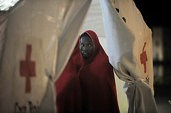 May 6, 2018 - Malaga, Spain - A migrant who was rescued from a dinghy in the Mediterranean Sea, stands inside a tent of Spanish Red Cross after his arrival at Port of Malaga. Members of the Spanish Maritime Safety rescued in this early morning a total of 110 migrants from two boats near the Malaga coast. (Credit Image: © Jesus Merida/SOPA Images via ZUMA Wire)