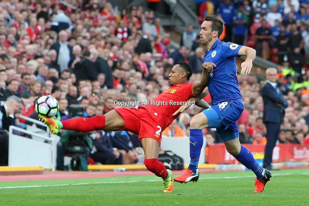 10.09.2016. Anfield, Liverpool, England. Premier League Football. Liverpool versus Leicester. Nathaniel Clyne of Liverpool stretches to keep the ball in play under the challenge of Christian Fuchs of Leicester City