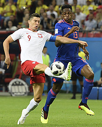 KAZAN, June 24, 2018  Robert Lewandowski (L) of Poland vies with Yerry Mina of Colombia during the 2018 FIFA World Cup Group H match between Poland and Colombia in Kazan, Russia, June 24, 2018. (Credit Image: © Lui Siu Wai/Xinhua via ZUMA Wire)