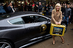 © Licensed to London News Pictures. 24/09/2012. LONDON, UK. Bond girl Britt Ekland, who played Bond Girl 'Goodnight' in 'The Man with the Golden Gun' is seen outside HMV with an Aston Martin DB5 from 'Quantum of Solice' in Oxford Street, London, today (24/09/12) during a photocall. The stars were in London during the final leg of a UK tour to promote the Bond 50 Blu-Ray collection.  Photo credit: Matt Cetti-Roberts/LNP