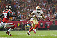 20 January 2013: Wide receiver (15) Michael Crabtree of the San Francisco 49ers catches a pass and runs against the Atlanta Falcons during the second half of the 49ers 28-24 victory over the Falcons in the NFC Championship Game at the Georgia Dome in Atlanta, GA.