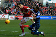 Bristol City defender Aden Flint blocks Birmingham City midfielder Jacques Maghoma  during the Sky Bet Championship match between Bristol City and Birmingham City at Ashton Gate, Bristol, England on 30 January 2016. Photo by Alan Franklin.