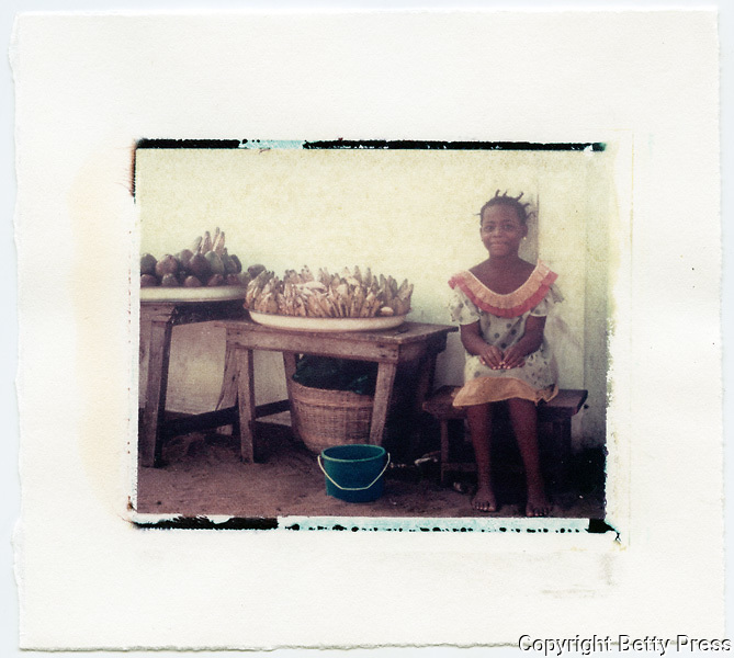 Young girl selling fruit in market, Lome, Togo<br />