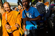 09 MAY 2013 - BANGKOK, THAILAND: Buddhist monks on their morning alms rounds in Bangkok.     PHOTO BY JACK KURTZ