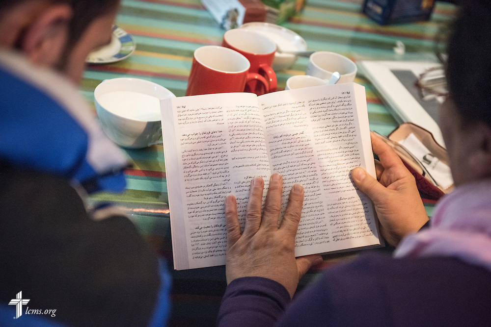 Christian refugees read from a translated Bible during a Bible study   on Friday, Nov. 13, 2015, near the Evangelisch-Lutherische St. Trinitatisgemeinde, a SELK Lutheran church in Leipzig, Germany. LCMS Communications/Erik M. Lunsford