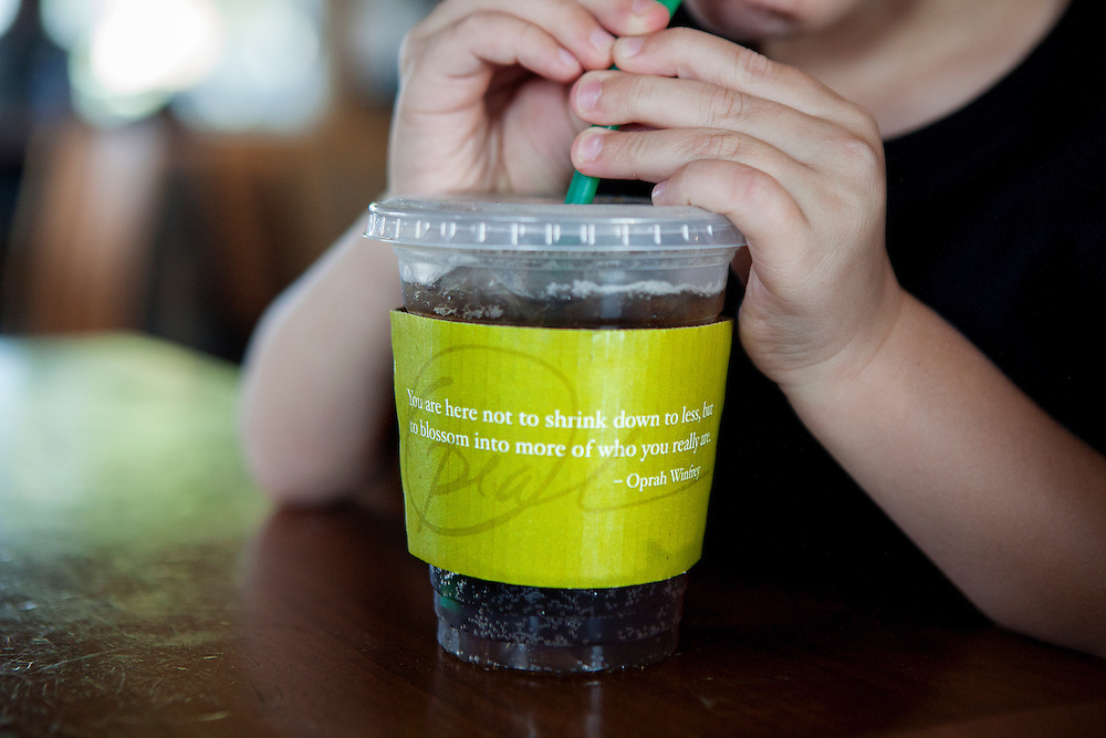 SAN DIEGO, CA - JULY 8, 2014:  Jannette Navarro's son Gavin drinks a root beer out of a Starbucks Coffee cup with an inspirational quote on the sleeve. CREDIT: Sam Hodgson for The New York Times