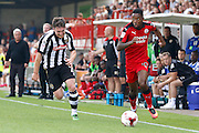 Crawley Town midfielder Jason Banton (10) runs down the line after getting past Notts County defender Matt Tootle (2) during the EFL Sky Bet League 2 match between Crawley Town and Notts County at the Checkatrade.com Stadium, Crawley, England on 27 August 2016. Photo by Andy Walter.
