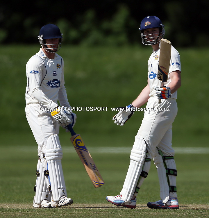 Aaron Redmond and Michael Bracewell after Michael reaches his half century while batting for Otago. Canterbury Wizards v Otago Volts, Mainpower Oval, Rangiora, Tuesday 30 October 2012. Photo : Joseph Johnson/photosport.co.nz