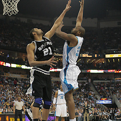 29 March 2009: Melvin Ely (33) shoots over San Antonio Spurs center Tim Duncan (21) during a NBA game between Southwestern Conference rivals the New Orleans Hornets and the San Antonio Spurs at the New Orleans Arena in New Orleans, Louisiana.