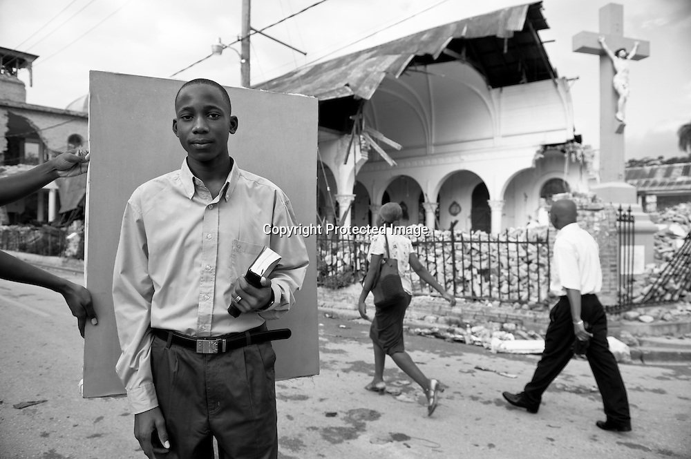 Garcon Kenzer, 13, makes his way to Sunday morning mass at Sacred Heart Catholic Church in Port-au-Prince. He was touched by the earthquake's tragedy first-hand with the death of his grandfather, but Garcon escaped his house unhurt. He's afraid to live in it, however, and sleeps in a tent in a friend's front yard.