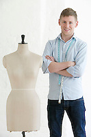 Tailor standing next to mannequin portrait