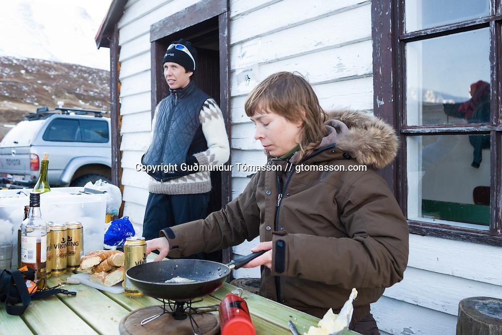 Helga Björt Möller cooking, Hvalvatnsfjörður, Iceland.