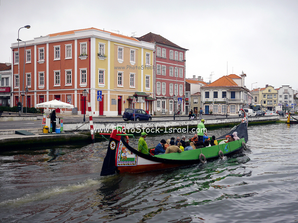 Tourists in a traditional fishing boat in Costa Nova, Portugal