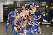 Barry Fuller (Captain) defender for AFC Wimbledon (2),Sean Rigg forward for AFC Wimbledon (11),Jake Reeves midfielder for AFC Wimbledon (8),Karleigh Osborne defender for AFC Wimbledon (22) ,Callum Kennedy defender for AFC Wimbledon (3),Andy Barcham midfielder for AFC Wimbledon (17), kitman Robin Bedford celebrate as AFC Wimbledon win promotion to league 1after the Sky Bet League 2 play off final match between AFC Wimbledon and Plymouth Argyle at Wembley Stadium, London, England on 30 May 2016. Photo by Stuart Butcher.