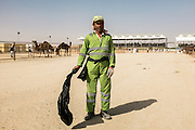 A worker at the Camel Beauty Contest during the Al Dhafra Festival near Abu Dhabi.