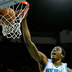 April 15, 2012; New Orleans, LA, USA; New Orleans Hornets small forward Al-Farouq Aminu (0) dunks against the Memphis Grizzlies during the second quarter of a game at the New Orleans Arena. The Hornets defeated the Grizzlies 88-75.  Mandatory Credit: Derick E. Hingle-US PRESSWIRE