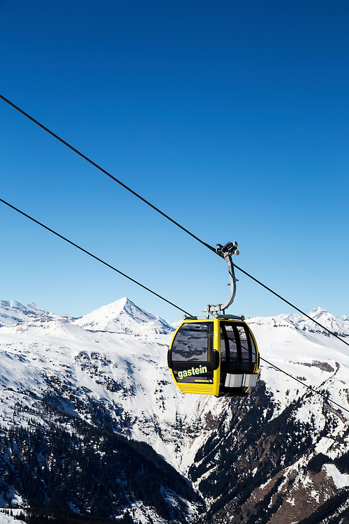 A cable car travelling above the ski slopes of Bad Gastein in the Austrian Alps. Bad Gastein is a major skiing area close to Salzburg offering extensive skiing and is famous for its health spas.