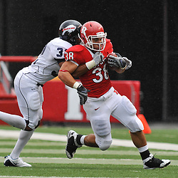 Sep 12, 2009; Piscataway, NJ, USA;  Howard cornerback Martin Corniffe (32) wraps up Rutgers running back Joe Martinek (38) during the first half of Rutgers' 45-7 victory over Howard in NCAA College Football at Rutgers Stadium.