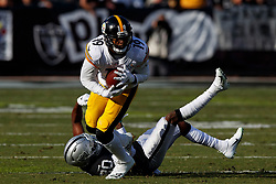 OAKLAND, CA - DECEMBER 09: Wide receiver JuJu Smith-Schuster #19 of the Pittsburgh Steelers breaks a tackle from cornerback Daryl Worley #20 of the Oakland Raiders during the second quarter at the Oakland Coliseum on December 9, 2018 in Oakland, California. The Oakland Raiders defeated the Pittsburgh Steelers 24-21. (Photo by Jason O. Watson/Getty Images) *** Local Caption *** JuJu Smith-Schuster; Daryl Worley
