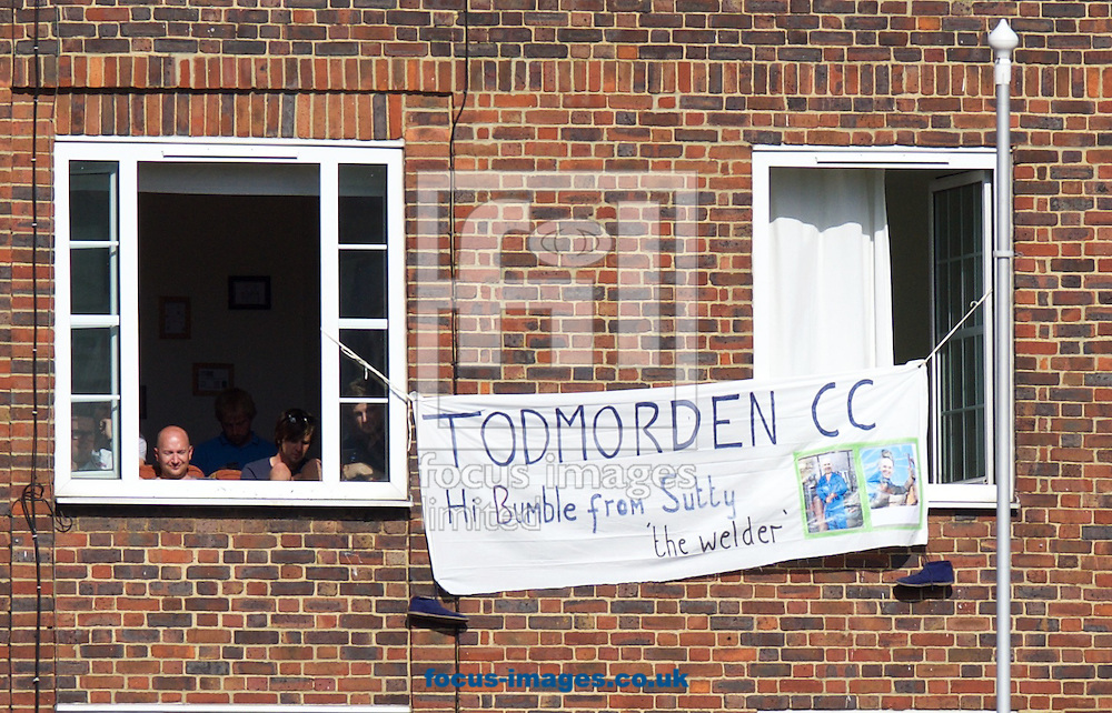A banner with a message for 'bumble' hangs from a window during the 5th Investec Ashes Test Match match at the Kia Oval, London<br /> Picture by Alan Stanford/Focus Images Ltd +44 7915 056117<br /> 21/08/2015