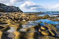 Weathered rocky coastline, Arniston, Western Cape, South Africa