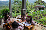 Students of Elementary school in Yogyakarta have a group discussion during class. 2017. The classroom was design without wall. One of the subject taught in this school, from first to sixth grade is organic farming.