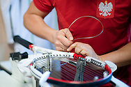 Jaroslaw Duda - stringer of Polish Tennis National Team prepares raquets while training session one day before the BNP Paribas Davis Cup 2014 between Poland and Croatia at Torwar Hall in Warsaw on April 3, 2014.<br /> <br /> Poland, Warsaw, April 3, 2014<br /> <br /> Picture also available in RAW (NEF) or TIFF format on special request.<br /> <br /> For editorial use only. Any commercial or promotional use requires permission.<br /> <br /> Mandatory credit:<br /> Photo by © Adam Nurkiewicz / Mediasport