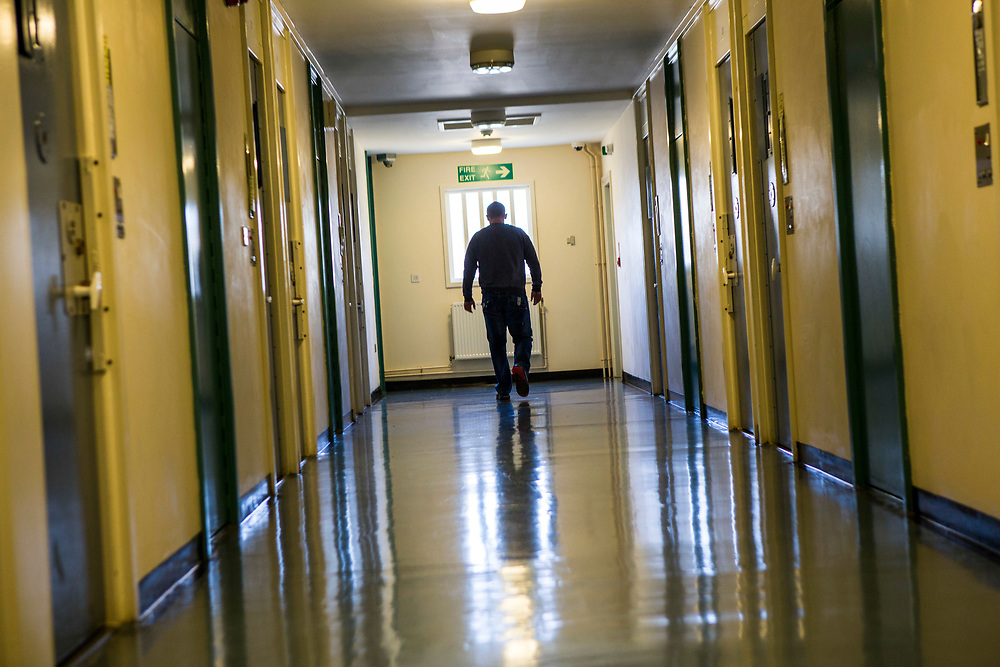 A prisoner walking down one of the corridors of the enhanced wing at <br /> HMP/YOI Portland, Dorset., United Kingdom.
